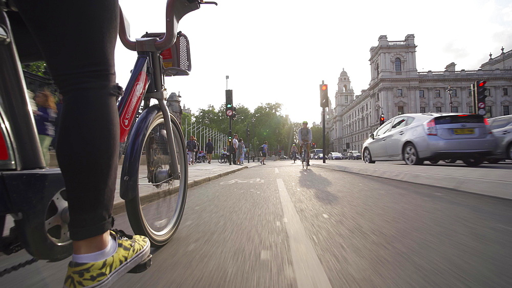 Santander city bike riding near Big Ben and Houses of Parliament, London, England, United Kingdom, Europe