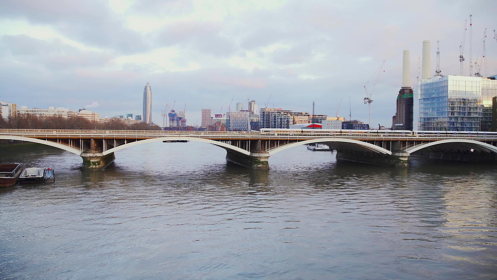 Train going over Grosvenor Bridge (Victoria Railway Bridge), River Thames and London skyline, London, England, United Kingdom, Europe