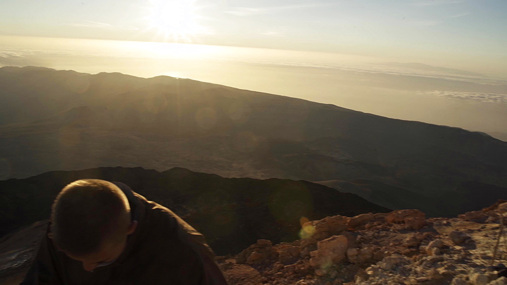 Hikers watching sunrise from top of the El Teide volcano, El Teide National Park, UNESCO World Heritage Site, Tenerife, Canary Islands, Spain, Atlantic, Europe
