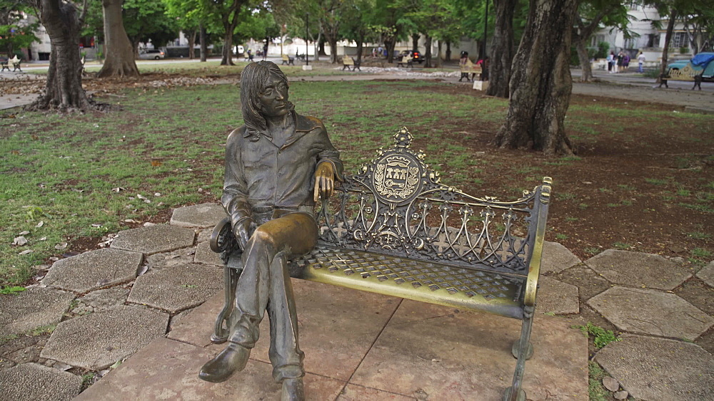 The statue of John Lennon sitting on a bench, La Habana (Havana), Cuba, West Indies, Caribbean, Central America