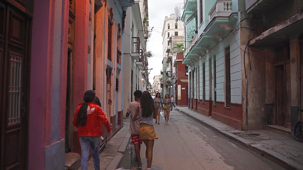 Shot through streets of old Havana at dusk, Cuba, West Indies, Caribbean, Central America