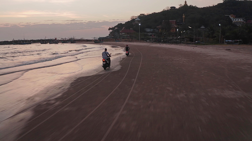 Drone aerial shot of rental scooters on Hua Hin beach, Prachuap Khiri Khan Province, Thailand, Southeast Asia, Asia