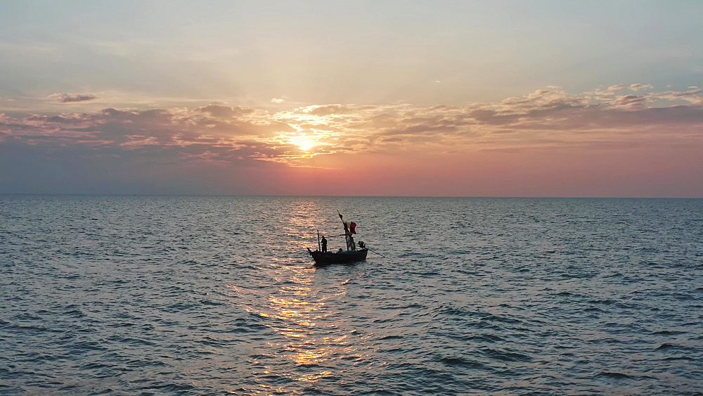 Drone aerial shot of a fisherman at sunset, Hua Hin beach, Prachuap Khiri Khan Province, Thailand, Southeast Asia, Asia