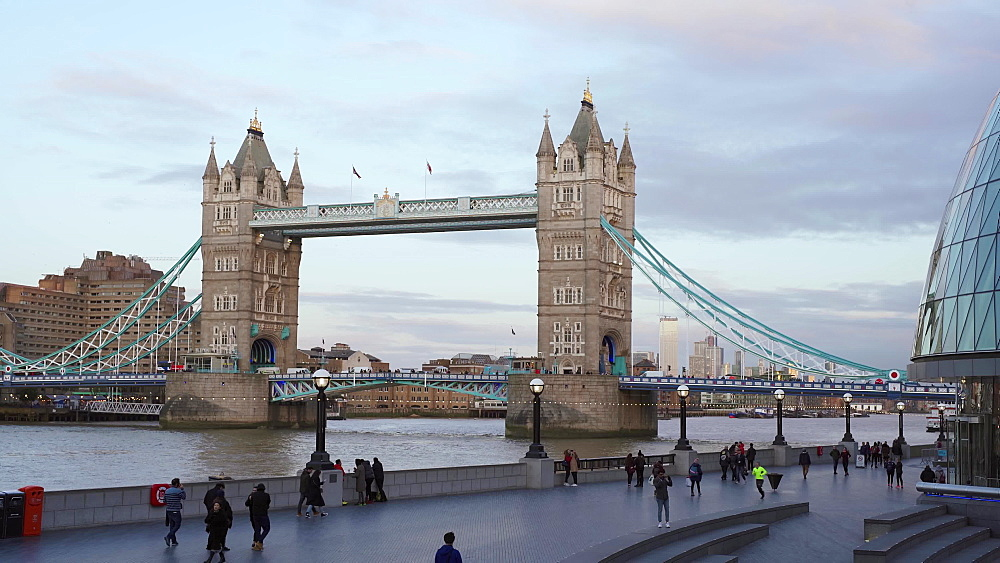 Traffic over Tower Bridge from busy St. Katherines Dock, London, England, United Kingdom, Europe