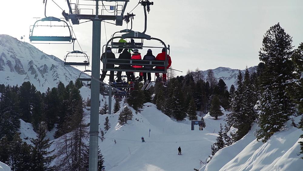 Going up the ski lift at La Plagne ski resort, Tarentaise, Savoy, French Alps, France, Europe