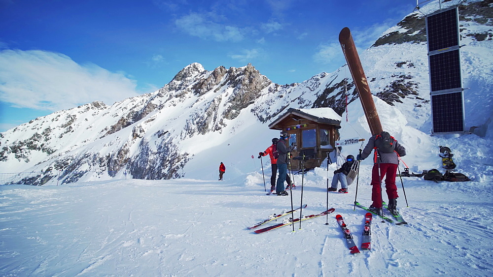 Skiers relaxing at the top of La Plagne ski resort, Tarentaise, Savoy, French Alps, France, Europe