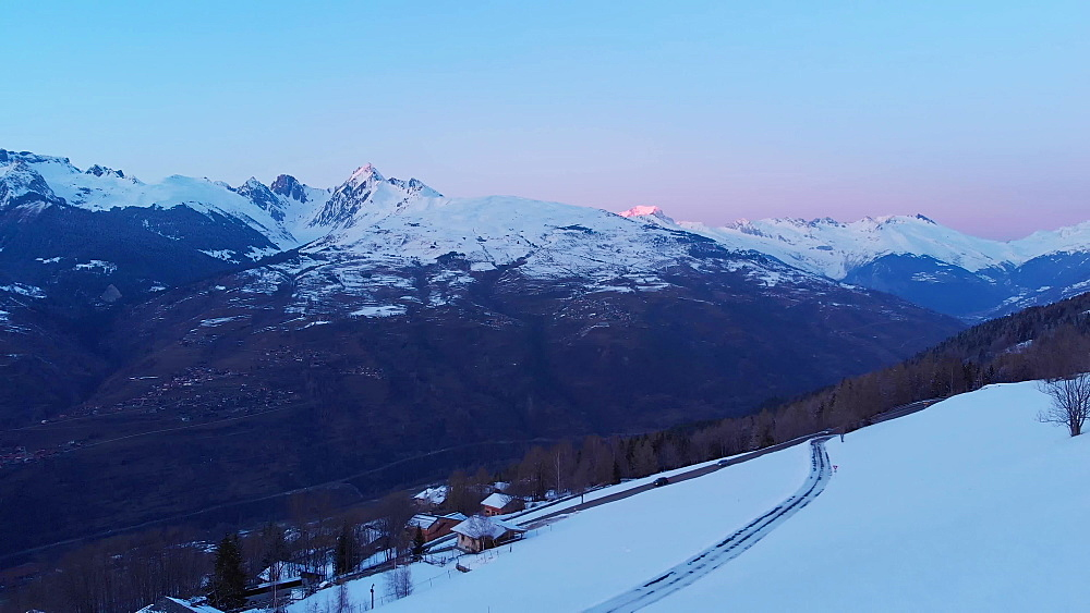 Aerial dusk drone shot, La Plagne ski resort, Tarentaise, Savoy, French Alps, France, Europe