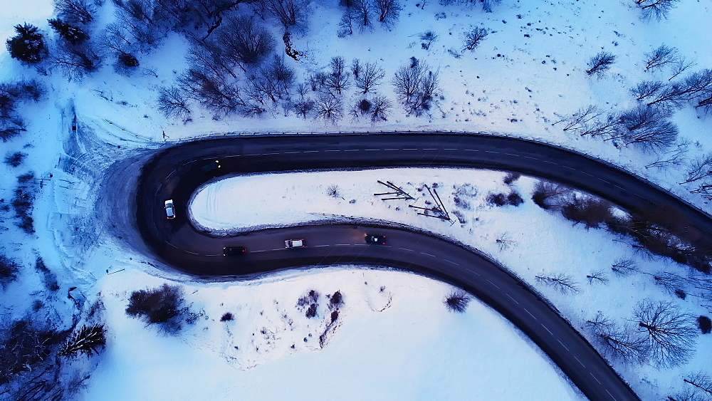 Aerial dusk drone shot of a road near La Plagne ski resort, Tarentaise, Savoy, French Alps, France, Europe