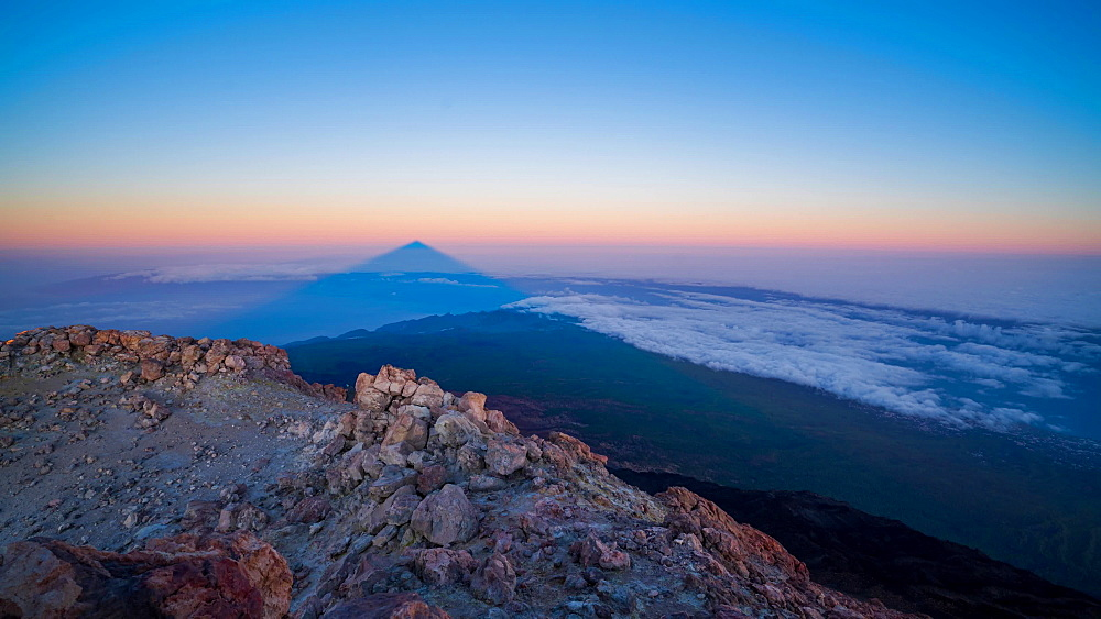 El Teide volcano (Mount Teide) shadow rising from the summit right before sunrise, Teide National Park, UNESCO World Heritage Site, Tenerife, Canary Islands, Spain, Atlantic, Europe