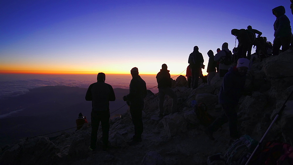 Hiker silhouettes at the top of the El Teide volcano (Mount Teide) before sunrise, Teide National Park, UNESCO World Heritage Site, Tenerife, Canary Islands, Spain, Atlantic, Europe