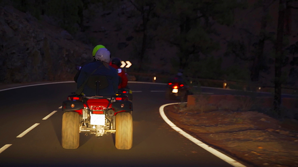 Tourists enjoying a quad bike trip around Teide National Park, Tenerife, Canary Islands, Spain, Atlantic, Europe