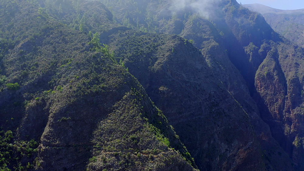 Drone view of foggy cliffs at Windows at the Guimar (ThoUSAnd Windows hike), Tenerife, Canary Islands, Spain, Atlantic, Europe