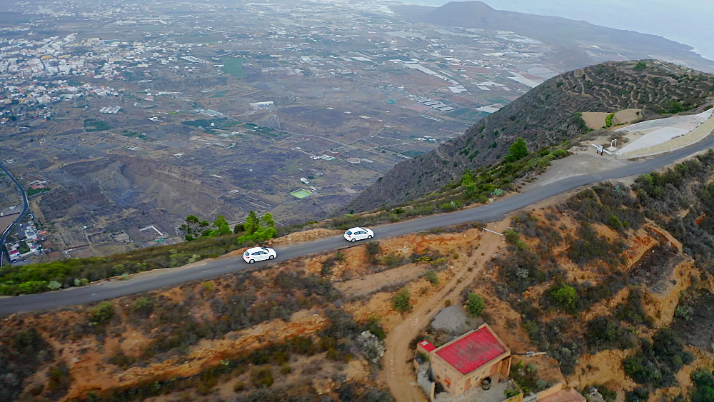 Drone view of a cars driving on narrow serpentine road on the island of Tenerife, Canary Islands, Spain, Atlantic, Europe
