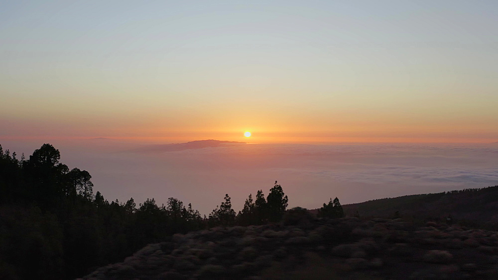 Drone view of a sunset above the clouds from Mount Teide National Park, Tenerife, Canary Islands, Spain, Atlantic, Europe