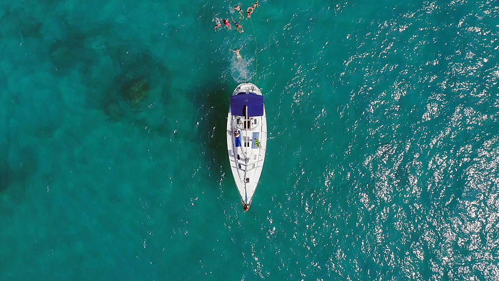 Drone aerial view of tourists enjoying a paradise luxury Yacht trip around Tenerife, Canary Islands, Spain, Atlantic, Europe