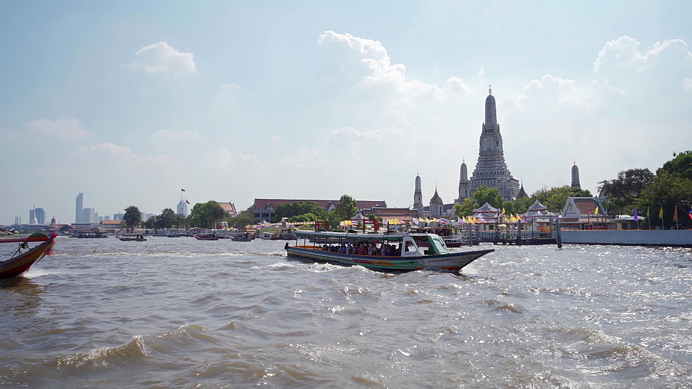Bangkok's skyline from ferry crossing Chao Phraya River, Bangkok, Thailand, Southeast Asia, Asia
