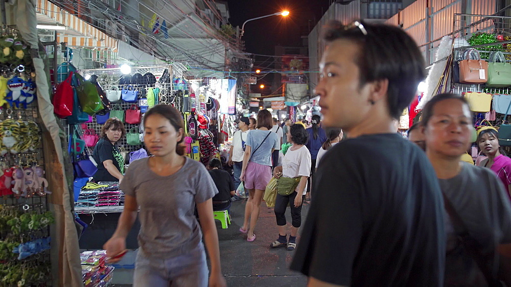 Gimbal video of night market full with people at Chinatown in Bangkok, Thailand, Southeast Asia