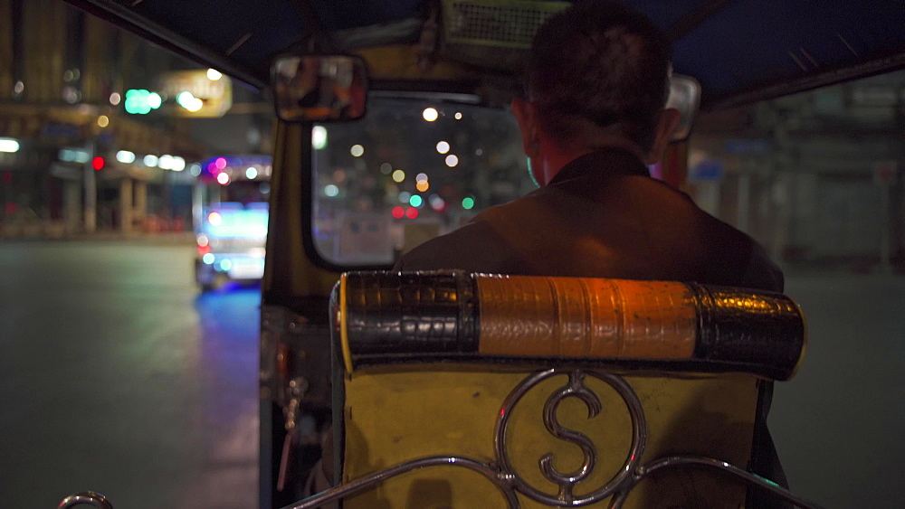View from inside a TUK TUK taxi driving through streets of Bangkok at night, Thailand, Southeast Asia, Asia