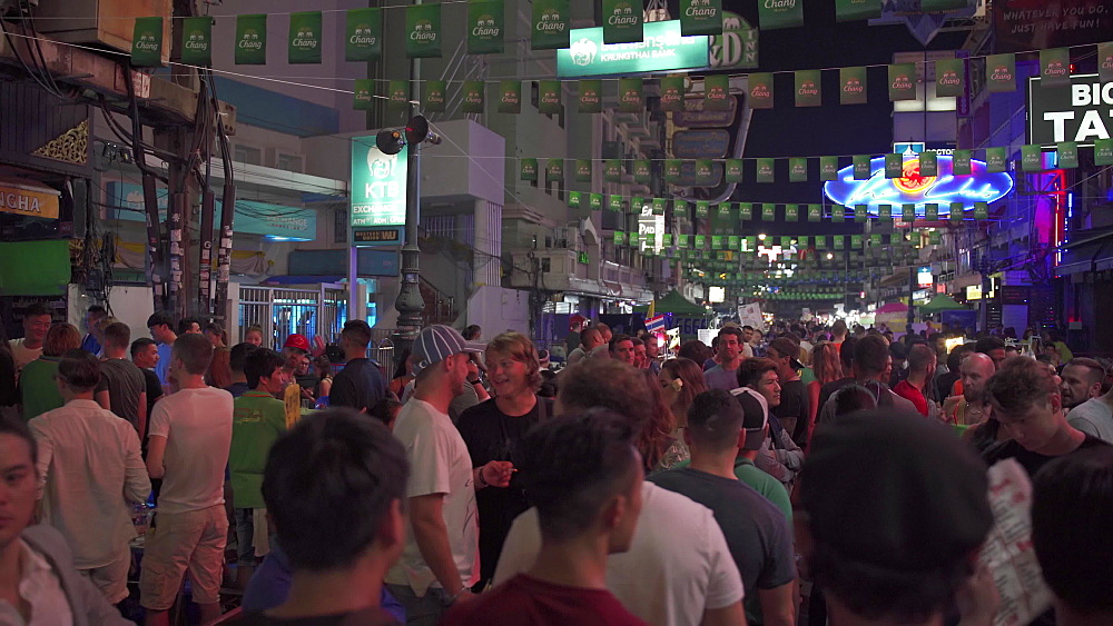 Gimbal video of very busy Khaosan Road and tourists partying at night, Bangkok, Thailand, Southeast Asia