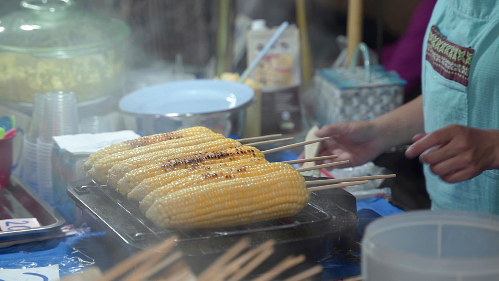 Grilled corn on the cob at night market in Chiang Mai, Thailand, Southeast Asia, Asia