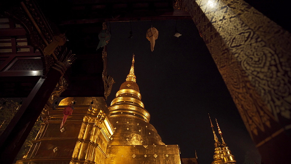 Lightning and thunderstorm over Wat Phra Singh Gold Temple at night, Chiang Mai, Thailand, Southeast Asia, Asia