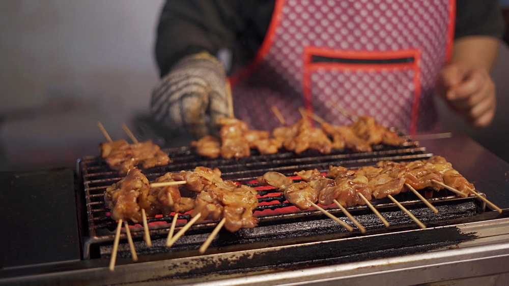 Grilled chicken on open flame at night market in Chiang Mai, Thailand, Southeast Asia, Asia