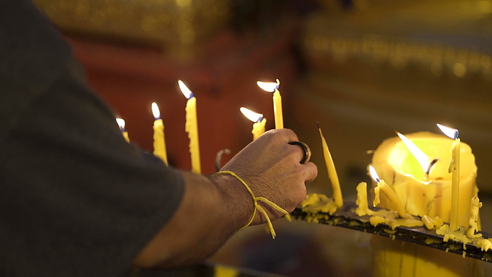 Close up of lighting candles at Wat Phra That Doi Suthep temple, Chiang Mai, Thailand, Southeast Asia, Asia