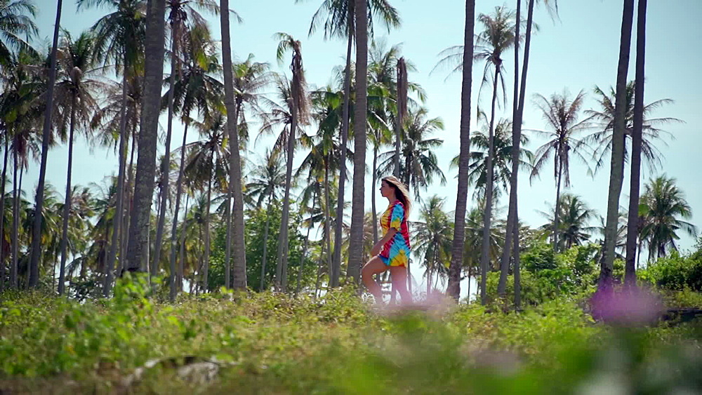 Video of a girl walking through a palm forest in Koh Lanta old town, Ko Lanta Island, Phang Nga Bay, Thailand, Southeast Asia, Asia