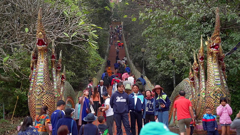 Video tourists walking the stairs to Wat Phra That Doi Suthep temple, Chiang Mai, Thailand, Southeast Asia, Asia
