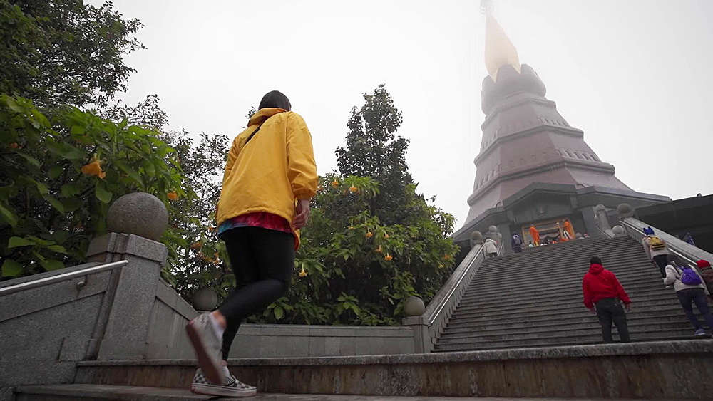 Tourist posing in front of King and Queen Pagodas, Doi Inthanon, Thailand, Southeast Asia, Asia