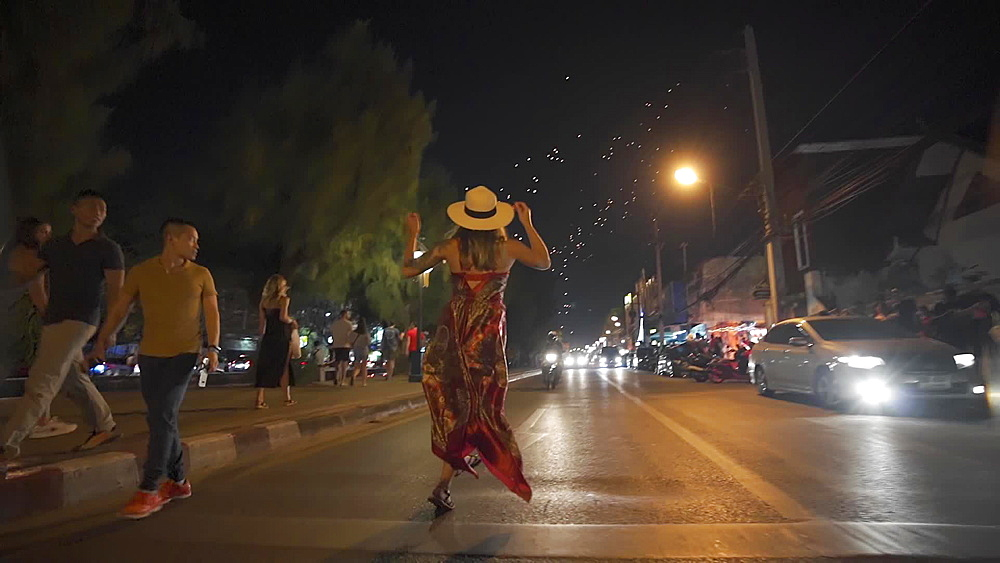Video of a tourist dancing in the middle of a street and celabrating Thai New Year's Eve 2019 - 2020, Chiang Mai, Thailand, Southeast Asia, Asia - 1276-2564