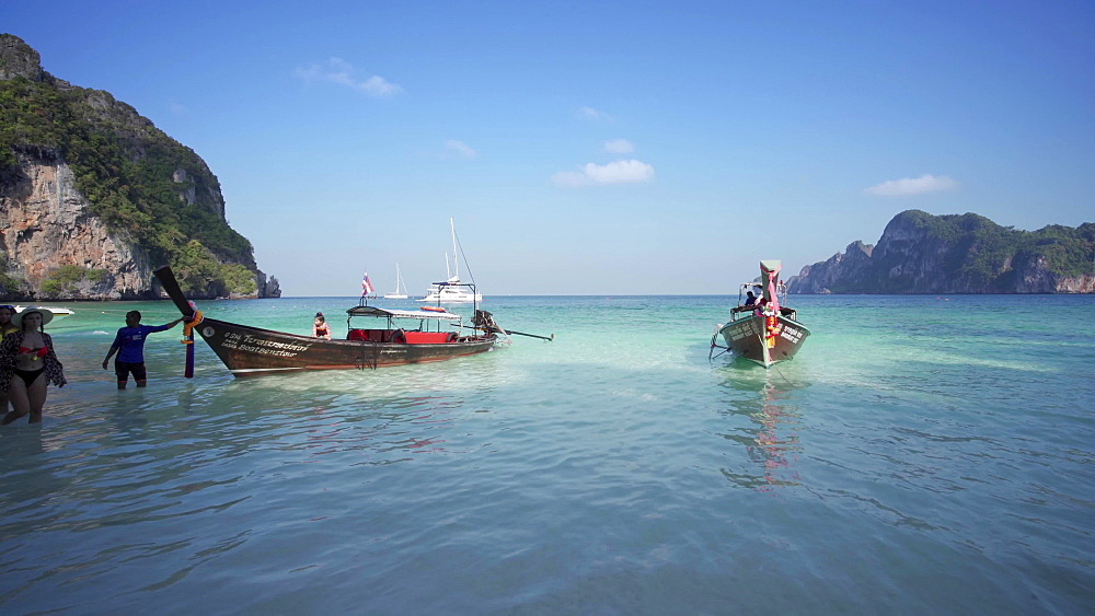 4k video of Maya Bay The Beach with long-tail boats and tourists at Christmas, Phi Phi Lay Island, Krabi Province, Thailand, Southeast Asia, Asia