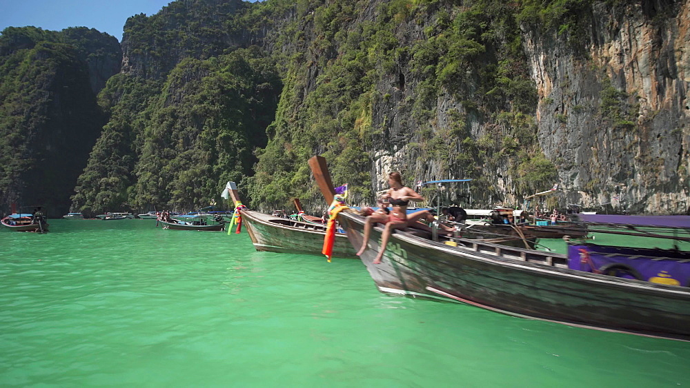 Maya Bay The Beach with long-tail boats and tourists at Christmas, Phi Phi Lay Island, Krabi Province, Thailand, Southeast Asia, Asia