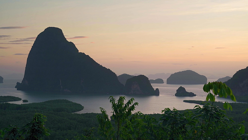 4k video of an amazing sunrise over famous rock formation from Samet Nangshe viewpoint, Phang Nga Bay National Park, Thailand, Southeast Asia