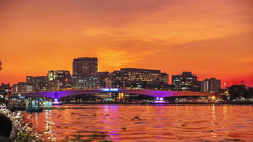 Timelapse video of Rama VIII Bridge at sunset from Santi Chai Prakan Public Park at dusk, Bangkok, Thailand, Southeast Asia, Asia