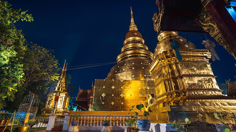 Timelapse video of Lightning and thunderstorm over Wat Phra Singh Gold Temple at night, Chiang Mai, Thailand, Southeast Asia, Asia