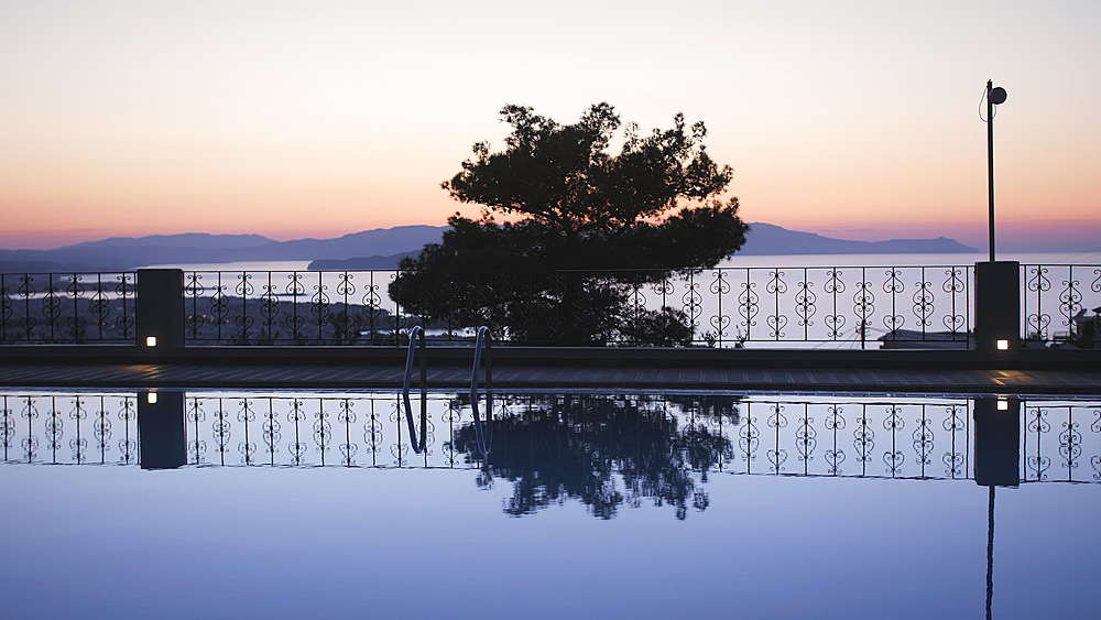 Largre swimming pool ans sunset over Chania, Crete, Greek Islands, Greece, Europea