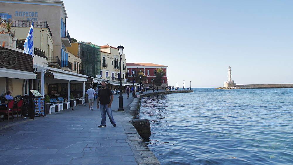The Venetian era harbour and lighthouse at the Mediterranean port of Chania, Crete, Greek Islands, Greece, Europe