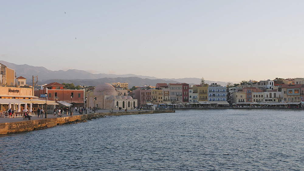 The Venetian era harbour at the Mediterranean port of Chania at dusk, Crete, Greek Islands, Greece, Europe