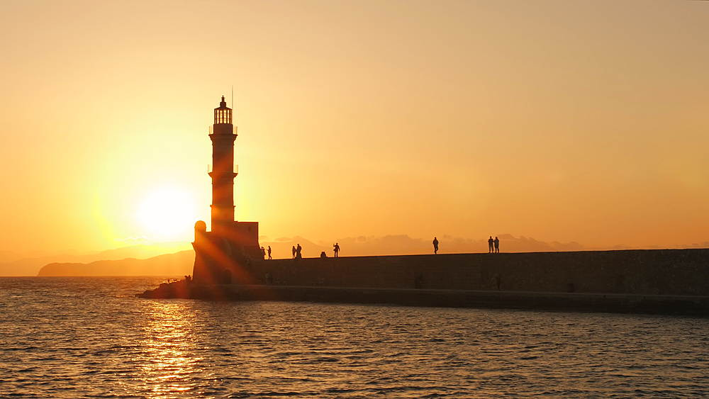 Sunset over The Venetian era harbour and lighthouse at the Mediterranean port of Chania, Crete, Greek Islands, Greece, Europe - 1276-645
