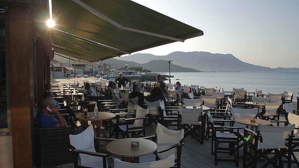 Restaurant at Paraliaki promenaad at sunset in Kissamos, Crete, Greek Islands, Greece, Europe