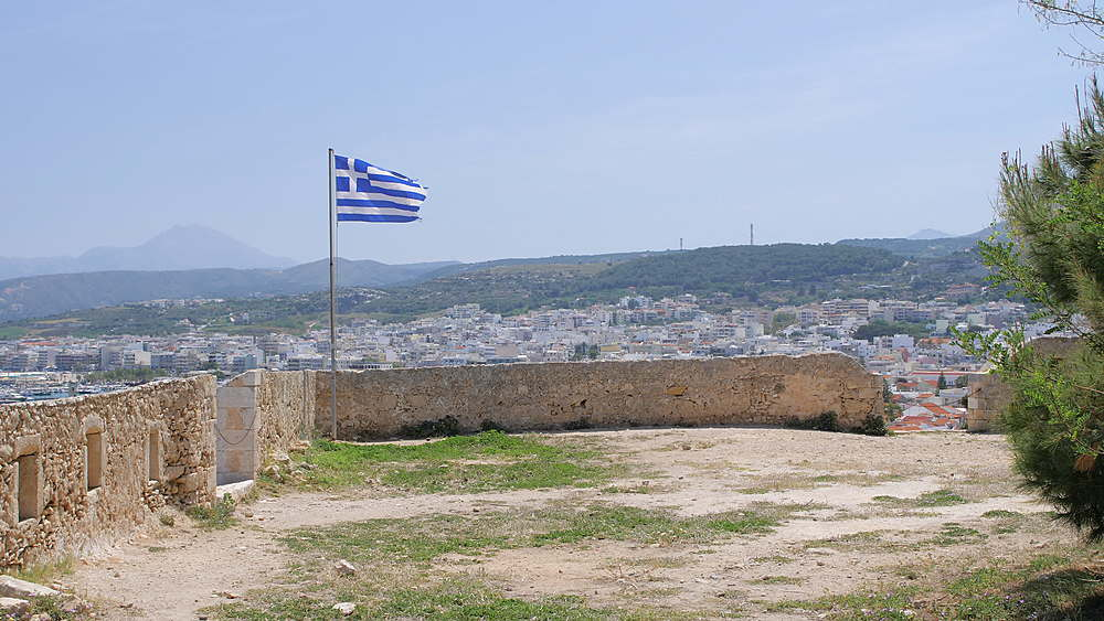Greek flag in Fortezza castle, Rethymnon, Crete, Greek Islands, Greece, Europe