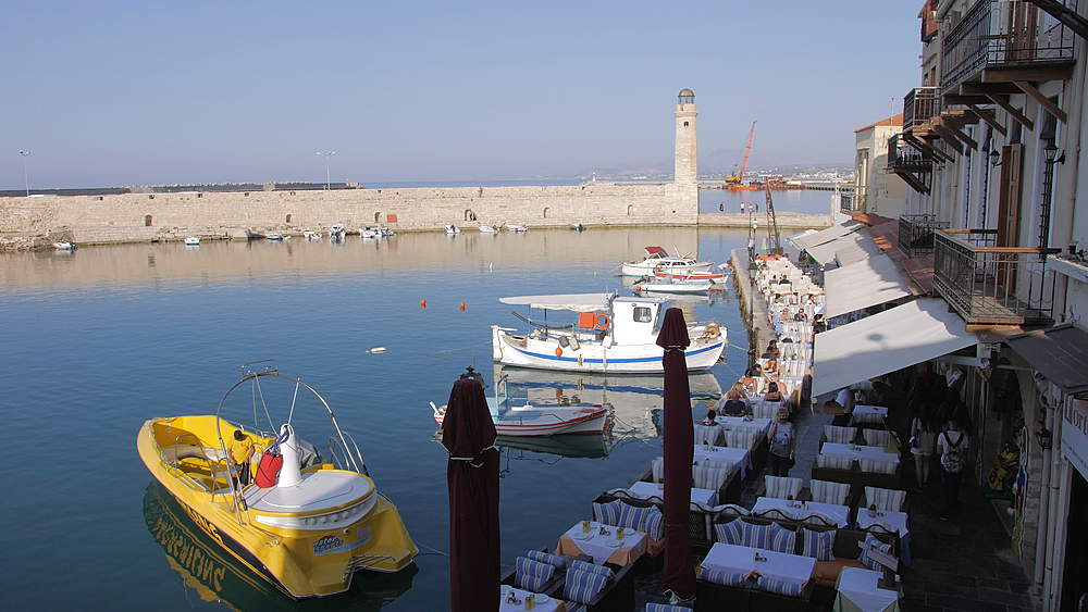 Lighthouse at old Venetian harbour, Rethymno, Crete, Greek Islands, Greece, Europe
