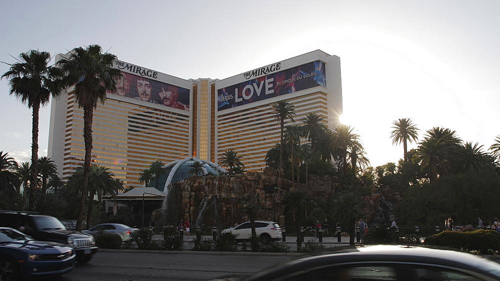 Sun peaking behing The Mirage Hotel and Casino, The Strip, Las Vegas Boulevard, Las Vegas, Nevada, USA, North America