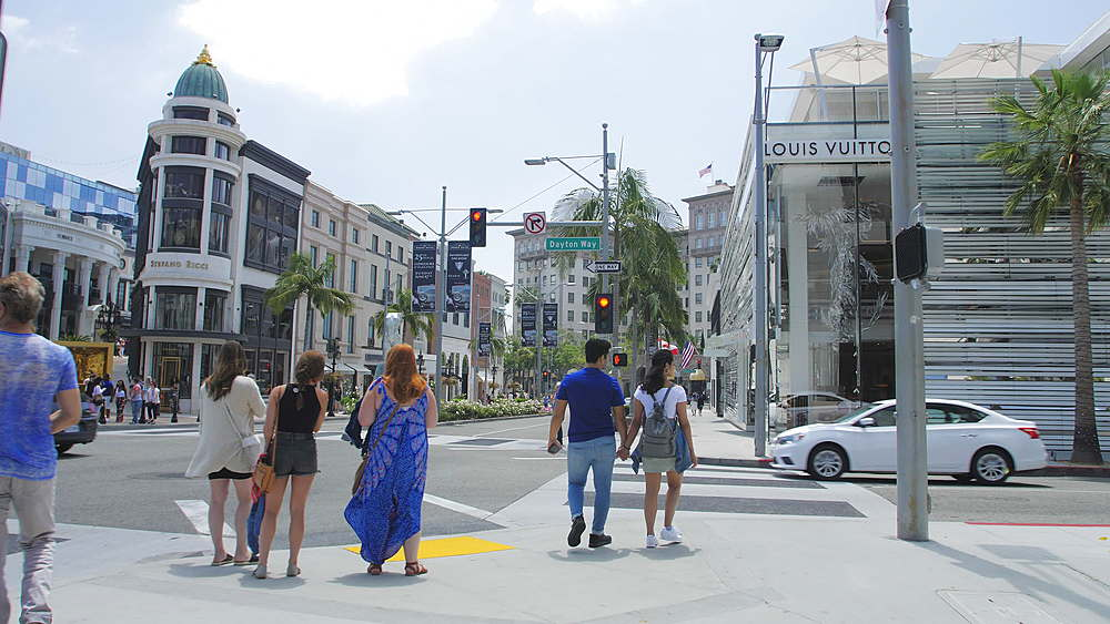 Tracking shot of people walking on Rodeo Drive, Beverly Hills, Los Angeles, LA, California, United States of America, North America - 1276-865