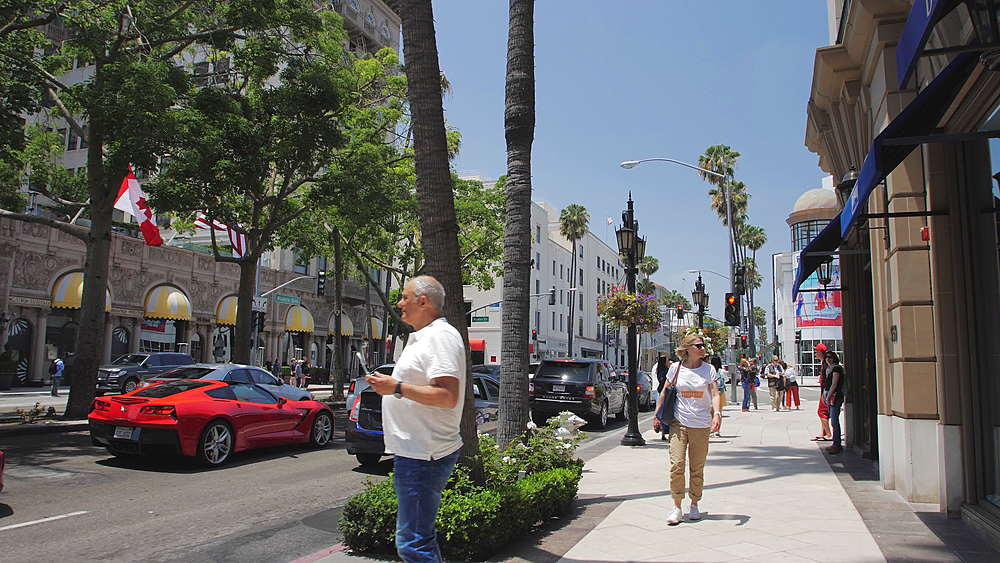 Tracking shot of Whilshie Blvd, Rodeo Drive, Beverly Hills, Los Angeles, LA, California, United States of America, North America - 1276-872