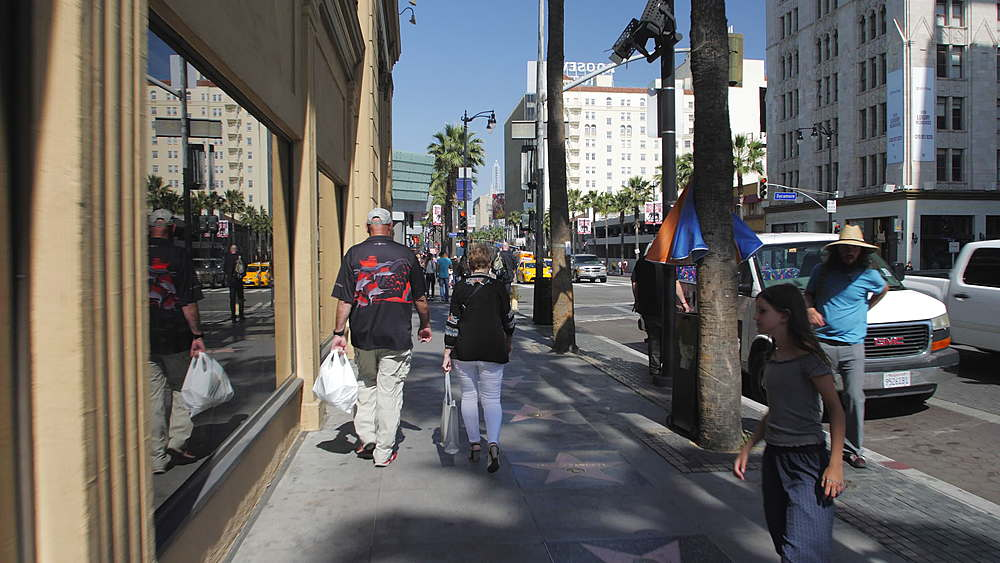 Tracking shot of Walk of Fame on Hollywood Boulevard, Hollywood, Los Angeles, LA, California, United States of America, North America - 1276-921