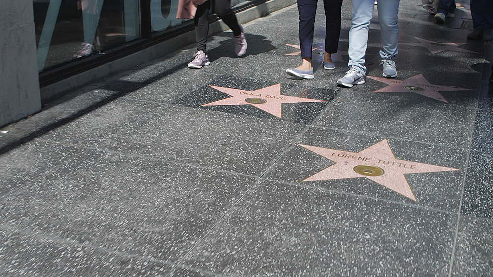 Tracking shot of Walk of Fame on Hollywood Boulevard, Hollywood, Los Angeles, LA, California, United States of America, North America - 1276-922