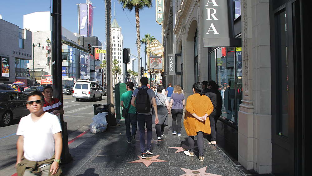 Tracking shot of Walk of Fame on Hollywood Boulevard, Hollywood, Los Angeles, LA, California, United States of America, North America - 1276-932
