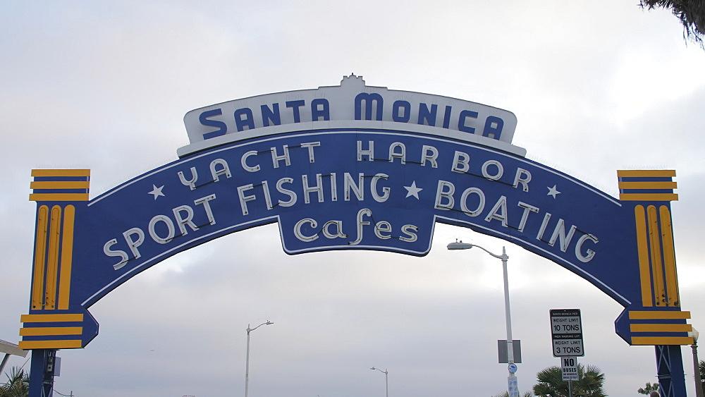 Santa Monica Pier entarance sign, Pacific Park, Beach, Santa Monica, Los Angeles, LA, California, United States of America - 1276-947